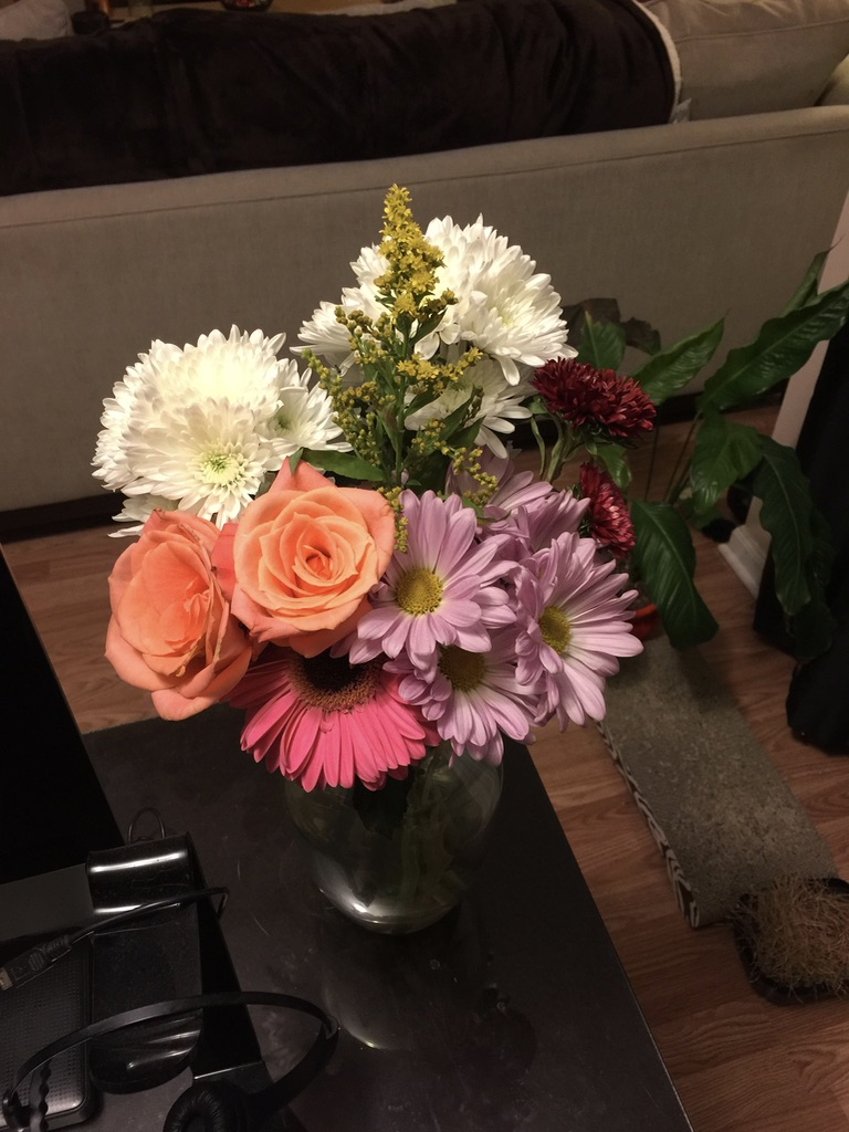 pink gerbera, white mums, purple daisies, and blooming peach roses